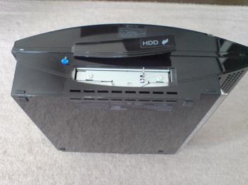 PS3 60GB SSD換装 6 HDDのユニットを右へスライド.JPG